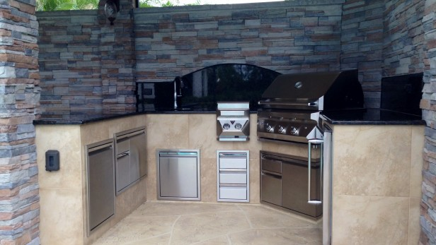 New roof addition features summer kitchen, stacked stone walls, and granite counter and backsplash.