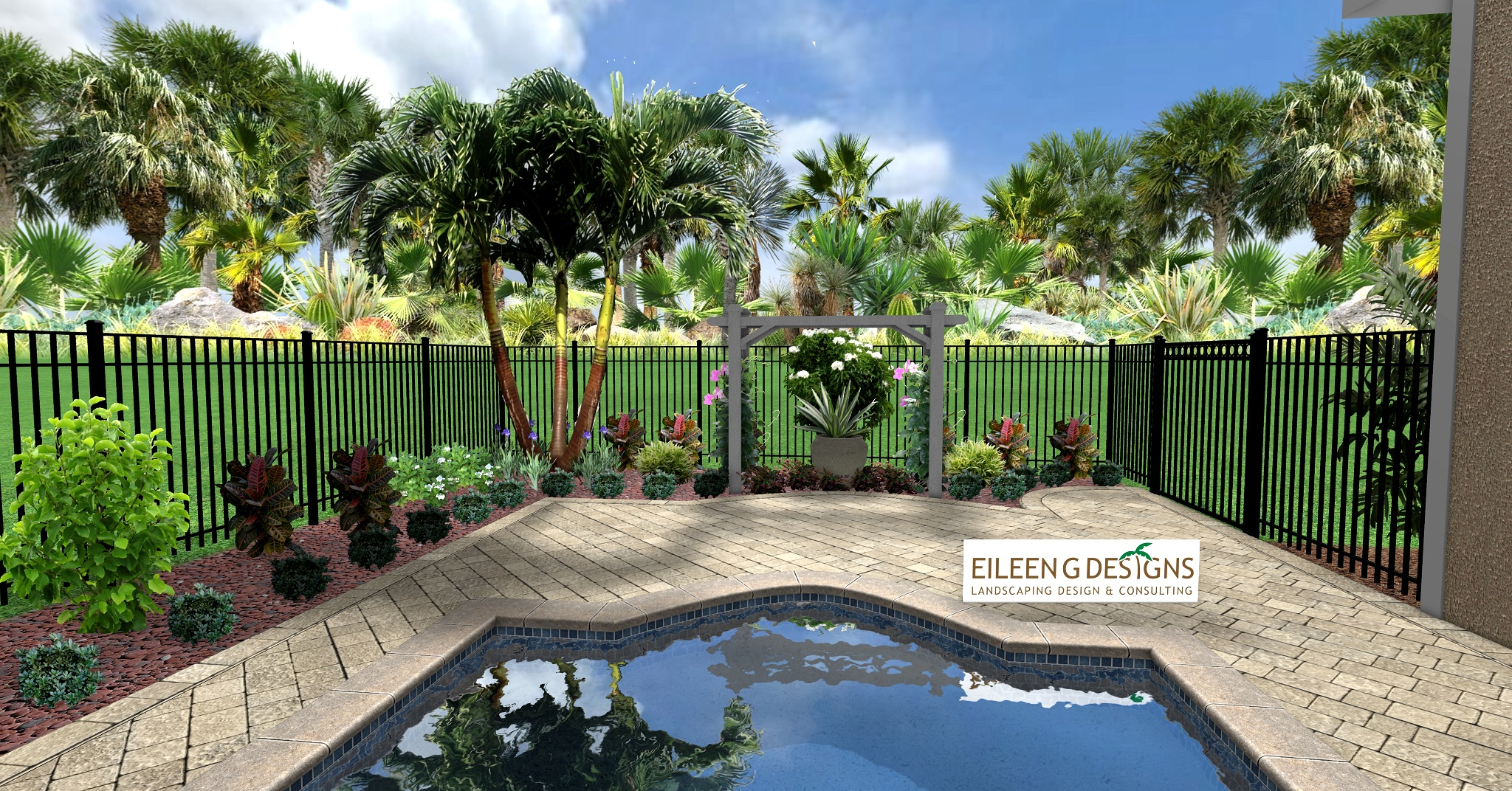 Paver pool deck and tropical landscaping for small back yard.